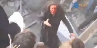 Screen capture of a video showing the murder of Farkhunda by a mob in Kabul, Afghanistan, on 19 March 2015. Image source: Wikipedia   ATN NewsATN News